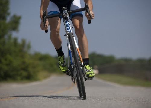 Riding a bicycle with proper gear - Natural Pain Management