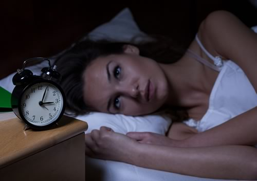 Woman can't sleep because of insomnia.